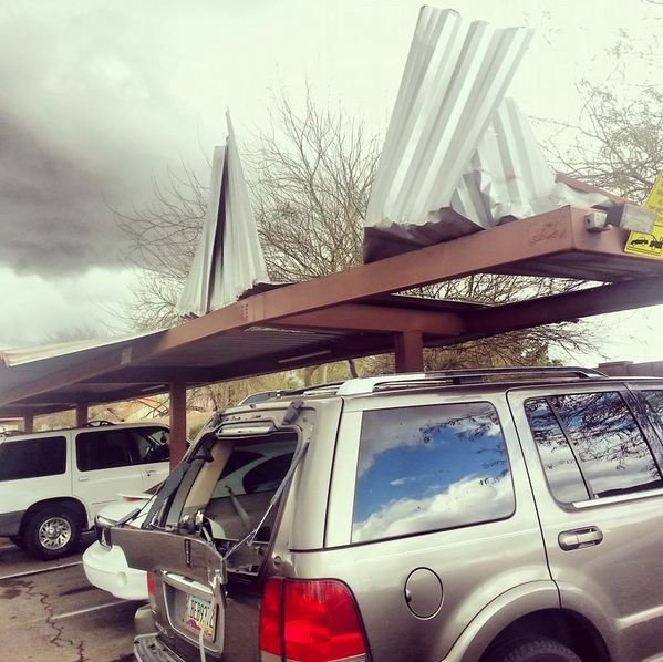 Car port awning damaged at Mesa apartment complex Saturday, (Source: Shawn Kline, cbs5az.com)