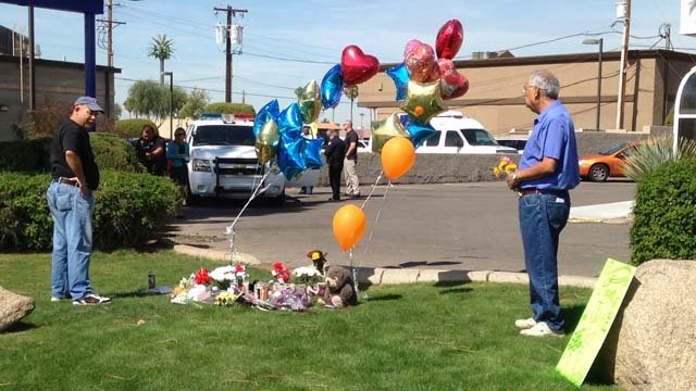 The early stages of a memorial at the site of the Monday's gun battle. (Source: CBS 5 News)