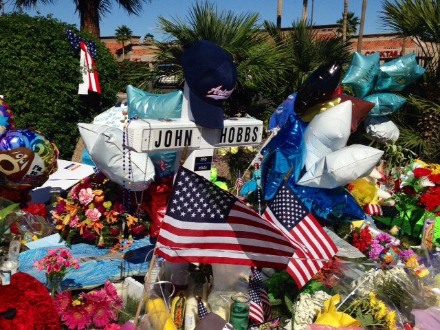 Memorial keeps growing at the site of the shooting. (Source: Christina Batson, cbs5az.com)