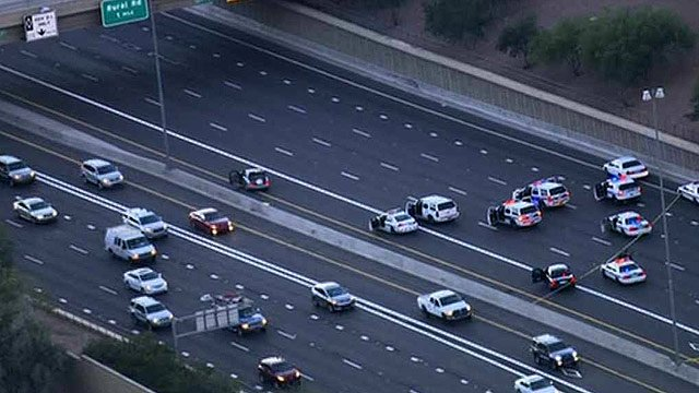 DPS vehicles close off eastbound U.S. Highway 60 in Tempe after an officer-involved shooting early Monday morning. (Source: Arizona Department of Transportation)