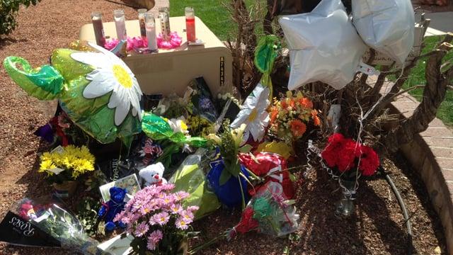 Friends, loved ones erect memorial at shooting site. (Source: Sean Gates, cbs5az.com)