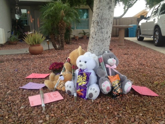 There's a growing memorial at 34th Drive for Austin. (Source: CBS 5 News)