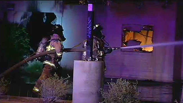 Mesa firefighters battle a fire that destroyed a former fast-food restaurant in a strip mall.