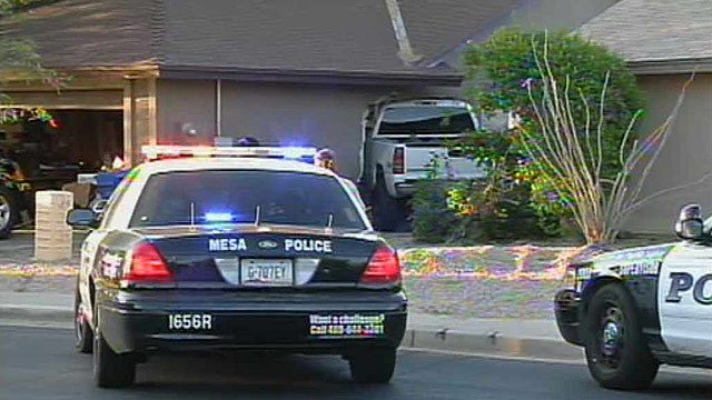 Mesa police were combing the neighborhood for the suspect, who climbed through the truck's windshield and ran through the house before escaping over a backyard fence.