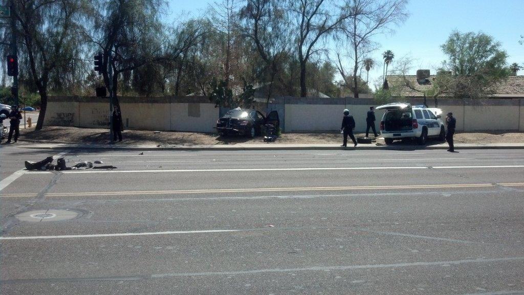 The Phoenix officer's vehicle was hit Thursday morning at the intersection of Sweetwater and 43rd Avenue