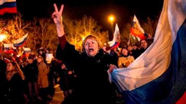Pro-Russian people celebrate in the central square in Sevastopol, Ukraine, late Sunday, March 16, 2014. (Source: AP Photo/Andrew Lubimov)