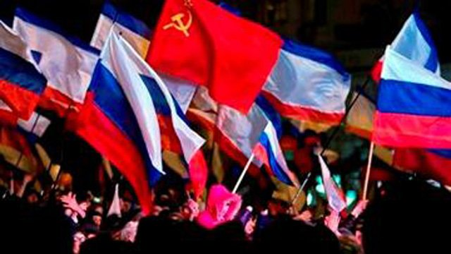Pro-Russian people celebrate in Lenin Square, in Simferopol, Ukraine, Sunday, March 16, 2014. (Source: AP Photo/Vadim Ghirda)