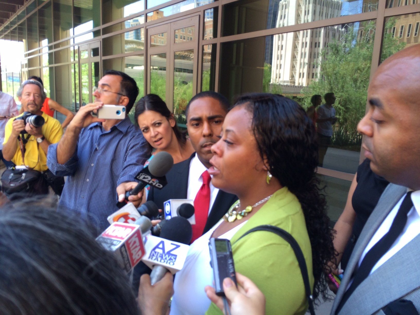Shanesha Taylor with lawyer following hearing (Source: CBS 5 News)