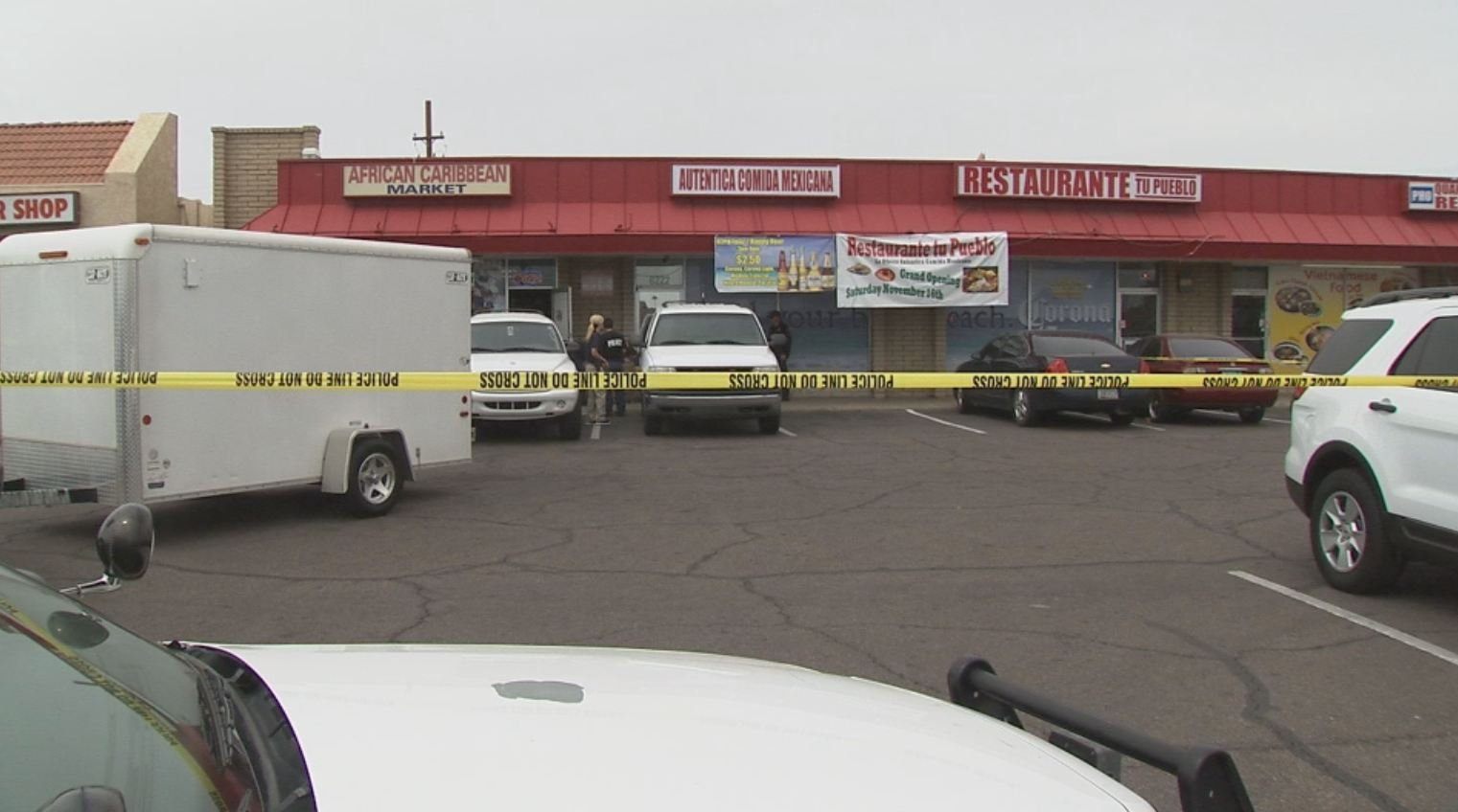 The Glendale Police SWAT team rushed into African Caribbean Market and arrested a husband and wife accused of running a multimillion-dollar fraudulent food stamp operation, the largest in Arizona history. (Source: CBS 5 News)