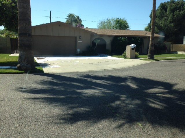 The attack happened Saturday in front of a vacant Phoenix home. (Source: Christina Batson, cbs5az.com)