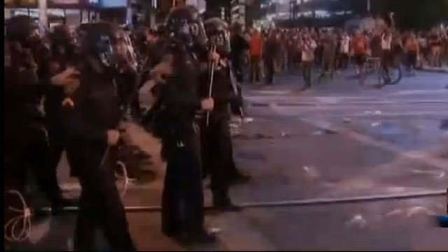 Tucson police clash with crowd after the University of Arizona basketball team lost in the NCAA tournament.