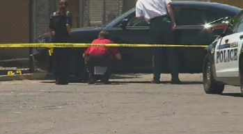 Officers investigate the vehicle where the victims were found. (Source: CBS 5 News)