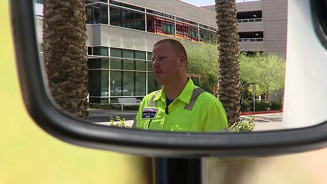 AAA tow truck driver Travis Brown used some quick thinking to help free Koontz and save his life. (Source: CBS 5 News)