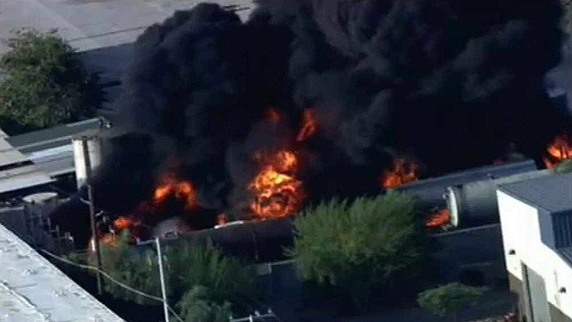 More than 100 firefighters battled Tuesday's blaze in an industrial area northwest of Phoenix Sky Harbor International Airport. (Source: CBS 5 News)