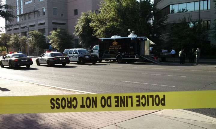 Tucson police investigate a suspicious package in front of the federal courthouse. (Source: KOLD-TV)