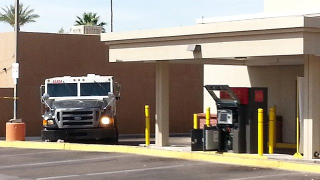 Phoenix police say a guard in this armored shot a man as he tried to rob them on Friday morning. The suspect later died. (Source: CBS 5 News)