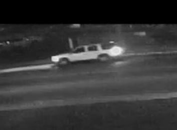 Investigators have provided a surveillance photo of the White 4-Door SUV they are attempting to locate.