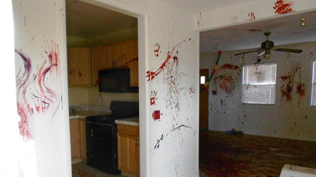 Vandals damaged walls and surfaces in every room with heavy paint splatter. (Source: Yavapai County Sheriff's Office)