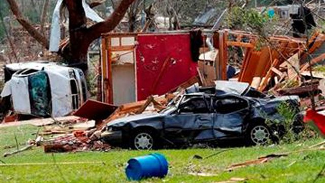 Destroyed automobiles and remnants of homes cover the ground in a south Louisville, Miss., neighborhood, Tuesday. (AP Photo/Rogelio V. Solis)