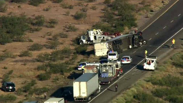 A semi rolled on Interstate 10 near Tonopah on Friday morning, completely blocking the westbound lanes. (Source: CBS 5 News)