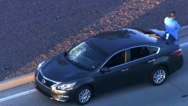 A jogger suffered life-threatening injuries when she was struck by this sedan in Glendale early Friday morning. (Source: CBS 5 News)