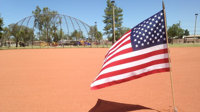 A flag is placed in memory of  Mendoza at Rotary Park, which the officer helped rehabilitate. (Source: Sean Gates, cbs5az.com)
