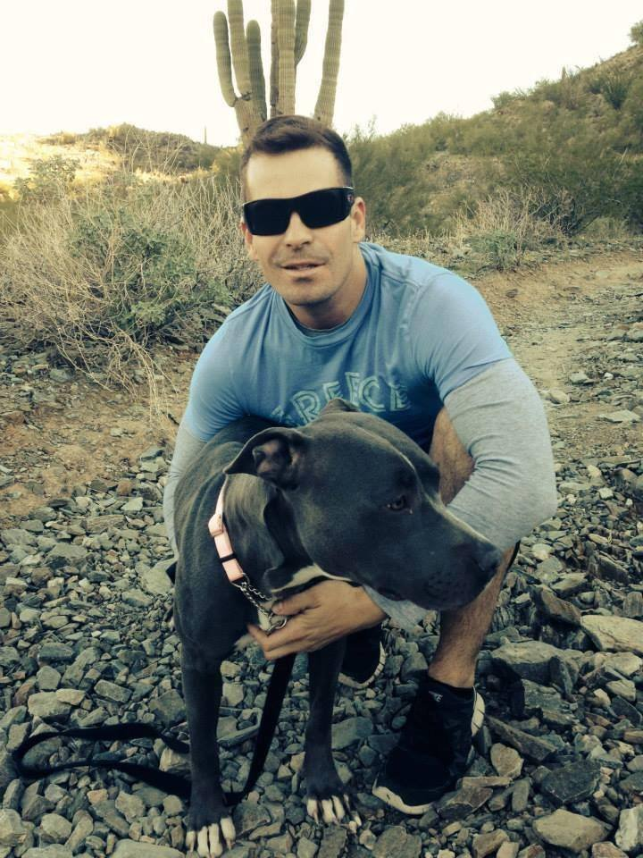 Officer Mendoza with pit bull he fostered.