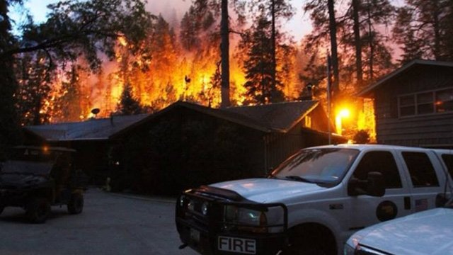Flames came dangerously close to homes.