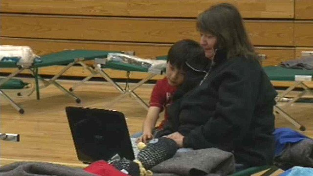 Laura Loh and her son grabbed some essentials before leaving their home, but had to leave the family cat behind. (Source: CBS 5 News)