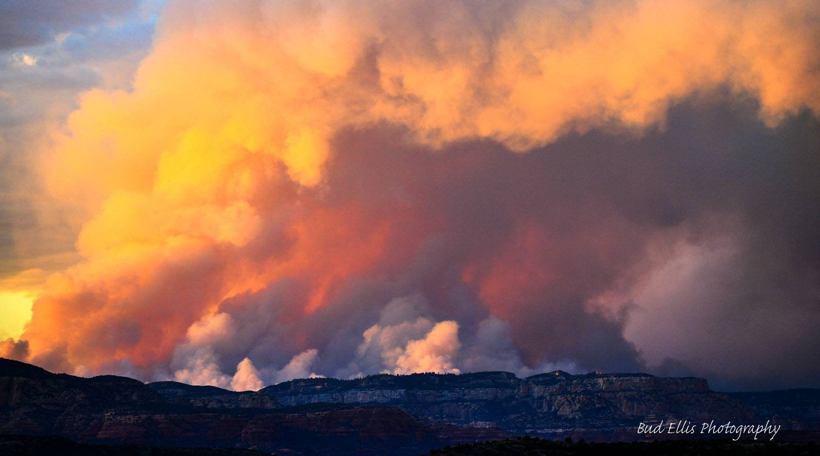 Photo taken about 15 miles south of Sedona on Memorial Day looking at the Slide Fire cloud of smoke illuminated by the sunset. (Source: Bud Ellis)