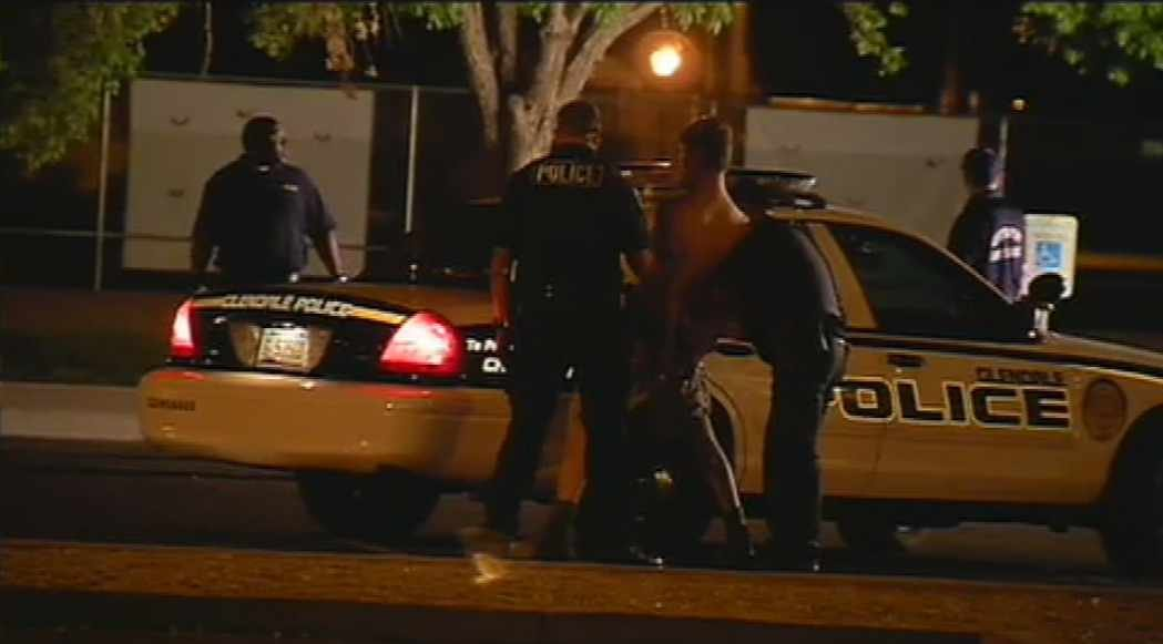 Glendale police pat down a suspect after a stabbing at a city park Wednesday night.
