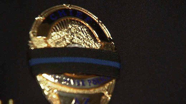 The two newest members of the Salt River Police Department graduated from the police academy Thursday with a shroud on their badges. (Source: CBS 5 News)