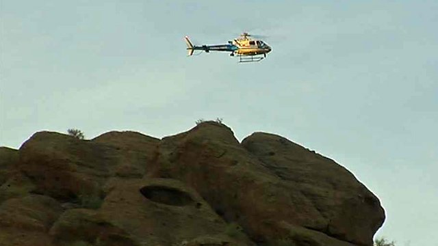 A Phoenix police helicopter helps look for missing hiker Eric Fernandes on Monday morning. (Source: CBS 5 News)