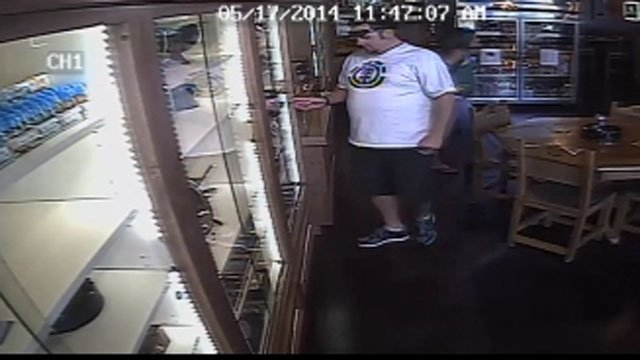 Surveillance image from camera at Big Sticks Fine Cigars on Dobson Road. (Source: Silent Witness)