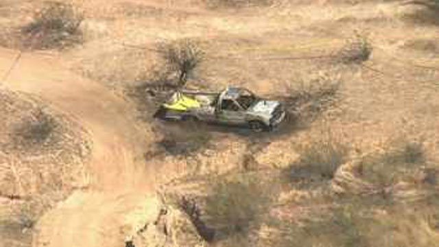 Three bodies were found inside a burning pickup truck in the desert in Surprise on June 9, police said. (Source: CBS 5 News)