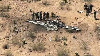 An NTSB report claims two planes heading in the same direction turned into each other before colliding in mid-air above the desert in north Phoenix.