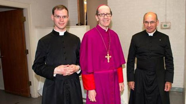 The Rev. Kenneth Walker, left, and the Rev. Joseph Terra, right flank Bishop Thomas Olmsted. Walker was shot and killed Wednesday night and Terra was badly injured. (Source: Catholic Diocese of Phoenix)