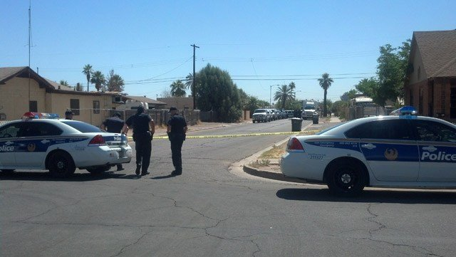 A suspicious device found behind an abandoned house turned out to be harmless Tuesday morning. (Source: Andrew Bautista / CBS 5 News)