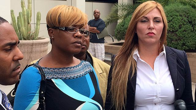 Ersula Ore, center, pleaded guilty to a misdemeanor charge of resisting arrest. (Source: CBS 5 News)