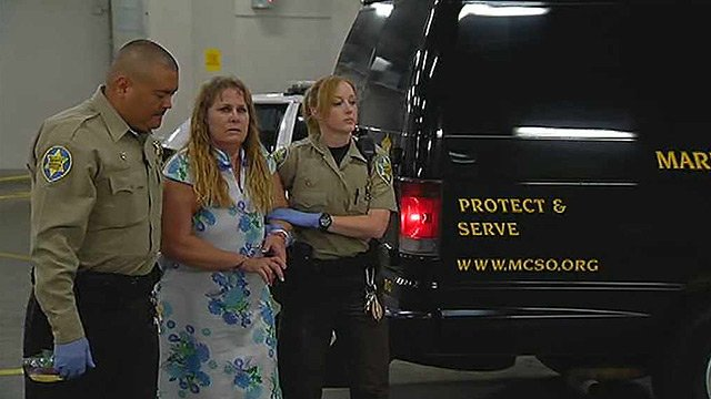 Carolyn Ferguson, 57, is brought to the Maricopa County Jail after she is suspected of kidnapping her granddaughter in California. (Source: CBS 5 News)