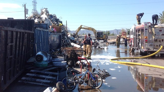 A downed power line is suspected of starting a fire in a pile of scrap at a Phoenix recycling yard Monday morning. (Source: Phoenix Fire Department)
