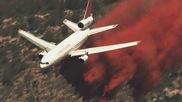 A DC-10 tanker spreads retardant on the Doce Fire near Prescott on Wednesday. (Source: CBS 5 News)