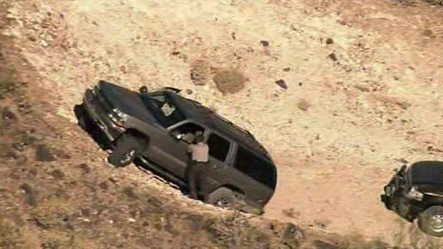 A man driving this stolen SUV led deputies on a chase that ended on this dead-end road. (Source: CBS 5 News)