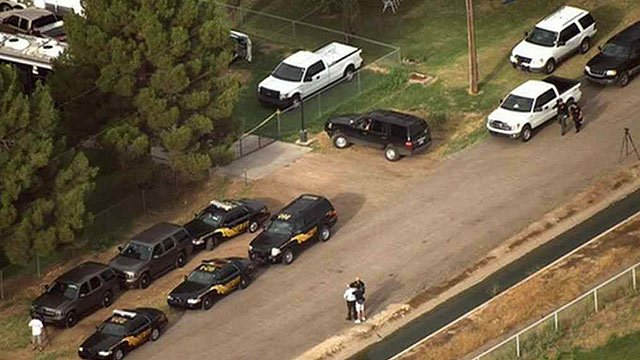 Several MCSO vehicles converged on Green Acres Dog Boarding in Gilbert to serve a search warrant. (Source: CBS 5 News)