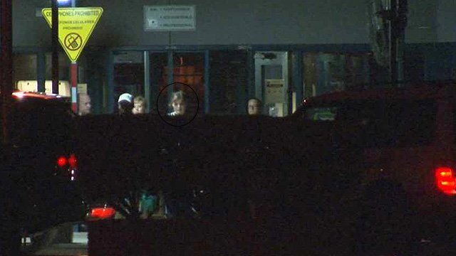Elizabeth Johnson, circled, walks out of the Perryville Prison just after midnight Friday. (Source: CBS 5 News)