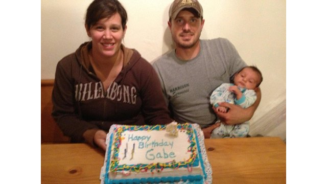 Logan McQueary, right, with his girlfriend, Becca, and son, Ashton, as they celebrate missing Gabriel Johnson's birthday in 2014. (Source: McQueary family photo)
