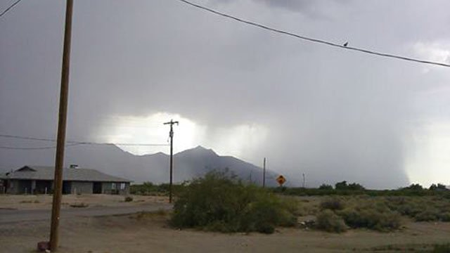 Rain shafts from a storm cell are seen in the Gila River Indian community in Laveen. (Source: Doreen Johnson)