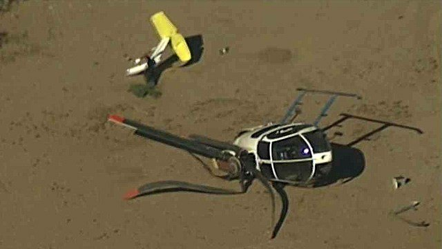 A pilot and two passengers escaped serious injury when engine problems forced this Pinal County Sheriff's Office helicopter down Tuesday morning. (Source: CBS 5 News)