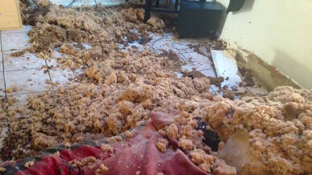Debris left from a roof cave-in during the storm in Phoenix. (Source: Christina Batson, cbs5az.com)