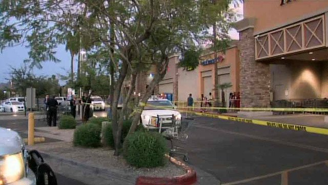 Phoenix police gather outside a Fry's grocery store where one person was wounded in a Sunday night shooting. (Source: CBS 5 News)
